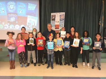 Maclary students take a group photo with author Timothy Young
