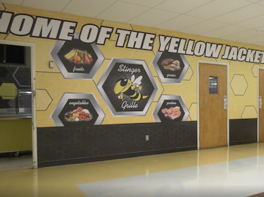 Home of the Yellowjackets wall mural in the cafeteria