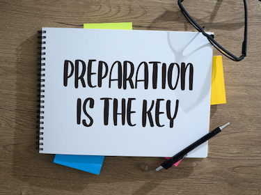 Notepad on a table with the words 'Preparation is Key'